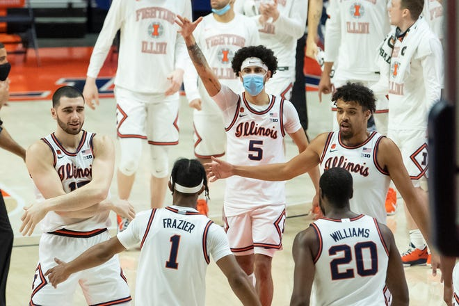 Feb 6, 2021; Champaign, Illinois, USA; The Illinois Fighting Illini celebrate after guard Trent Frazier (1) scores during the second half against the Wisconsin Badgers at State Farm Center.