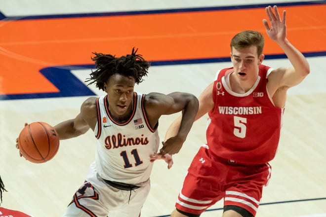Feb 6, 2021; Champaign, Illinois, USA; Illinois Fighting Illini guard Ayo Dosunmu (11) drives against Wisconsin Badgers forward Tyler Wahl (5) during the first half at State Farm Center.