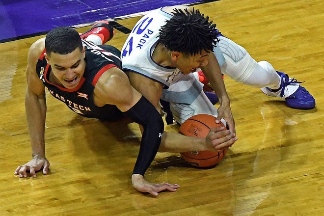 Texas Tech's Kevin McCullar (right) and Kansas State's Nijel Pack fight for a loose ball during a Big 12 Conference game Saturday at Bramlage Coliseum in Manhattan, Kansas. McCullar finished with 15 points and six rebounds in the No. 13 Red Raiders 73-62 win over the Wildcats. [Scott Weaver/Kansas State Athletics]