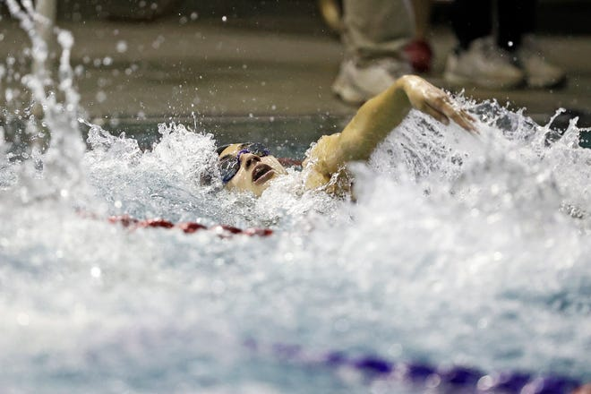El Paso High's Noemi Melendez swims in the 100-yard backstroke during the 5A Regional Girl's Swimming Championship, Friday, Feb. 5, 2021, at Pete Ragus Aquatic Center in Lubbock, Texas.