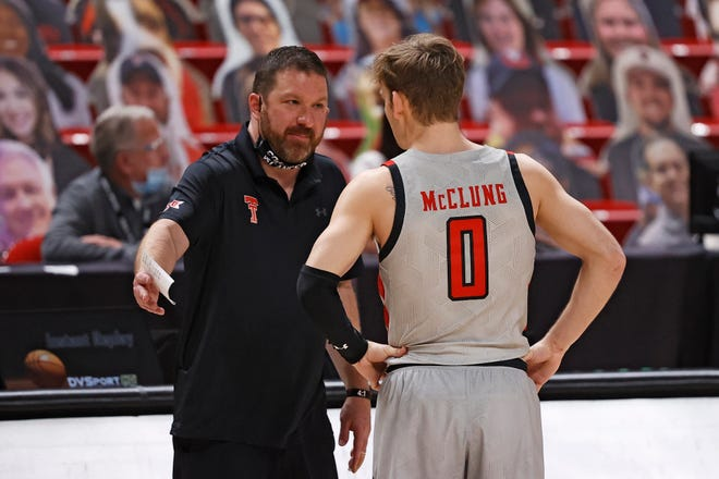 Texas Tech coach Chris Beard talks to Mac McClung (0) during the second half of a Big 12 Conference game Monday against Oklahoma at United Supermarkets Arena. McClung finished with six points, all from the free-throw line, to help the No. 13 Red Raiders beat No. 9 OU 57-52. [AP Photo/Brad Tollefson]