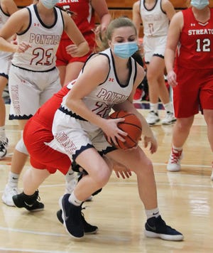 Pontiac senior Alyssa Fox keeps control of the ball during Friday's girls' basketball game with Streator. Fox, one of three seniors on the PTHS squad, was honored before the game.
