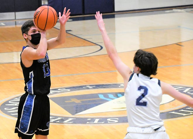 Oyster River's Wolfe Ramsay, left, drained four 3-pointers and scored 15 points in Friday's 57-43 win at St. Thomas Aquinas Friday night.