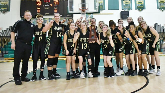 The Jupiter Warriors pose with trophy in hand after defeating Palm Beach Lakes to win the district championship. Jupiter was the contest 50-47 behind a strong second half surge.