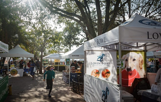 "Early crowds begin to form during the City of West Palm Beach GreenMarket in downtown West Palm Beach, Fla., on Saturday, February 6, 2021. The marketing tagline for the market this year is ""Lettuce Shop Safely."""