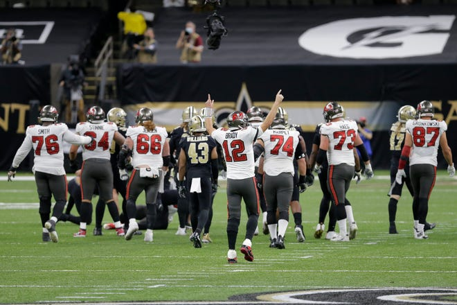 Buccaneers quarterback Tom Brady celebrates a key first down against the Saints during their divisional round playoff game on Jan. 17 in New Orleans. The Bucs would win, 30-20, and move on to the NFC Championship Game against the Green Bay Packers.