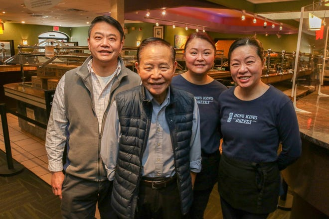 """The Chan family has the second generation running Hong Kong Buffet. Chi Chan, front, is the """"retired"""" father and founder. Back row is  son Wai Chan and daughter Mindy Chan and daughter-in-law Cindy Chan."""