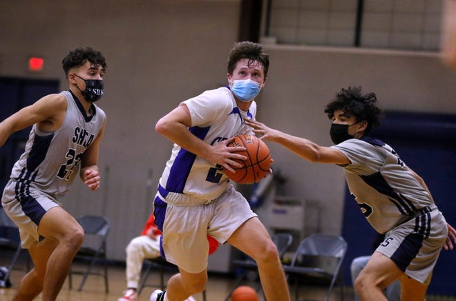 Jackson Walsh (shown in action earlier this season) and the Cumberland boys basketball team picked up a non-league win over Lincoln on Friday night.