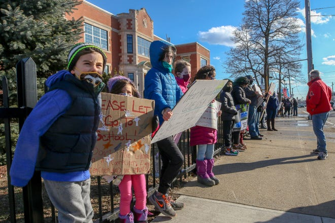 Parents and children demonstrate Saturday in front of Potter Burns Elementary School in Pawtucket to express their frustration with distance learning. Pawtucket is the only district in the state that does not have some form of in-person instruction.