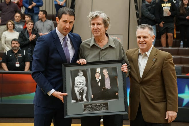 Journal sports columnist Bill Reynolds, center, is presented with an award by Brown basketball coach Mike Martin, left, and athletic director Jack Hayes last February before Reynolds' induction last spring into the National College Basketball Writers Hall of Fame.