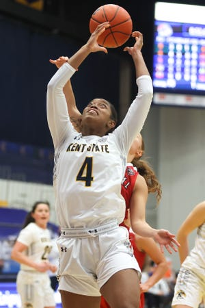 Kent State sophomore forward Nila Blackford leaps up for a rebound during Saturday's game against Miami at the M.A.C. Center.