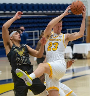 Kent State sophomore forward Evan Bainbridge pulls down a rebound over Akron's Michael Wynn during last February's battle at the M.A.C. Center.