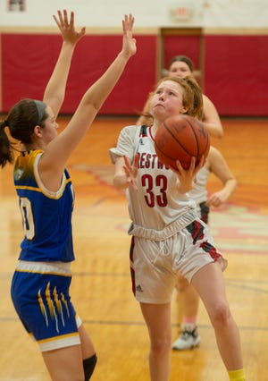 Crestwood hosted Lake Center Christian, with the Tiger's taking the win, 58-50. Kylie Krupp takes a shot, Faith West on defense.