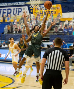 University of Akron guard Loren Christian Jackson drives the lane for a basket during the Zips' 72-61 win over rival Kent State on Friday night at the M.A.C. Center in Kent. [Lisa Scalfaro/Record Courier]