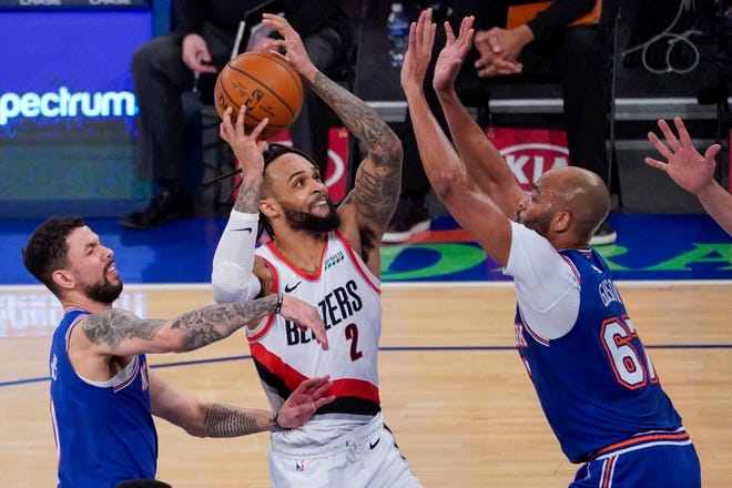 Portland's Gary Trent Jr. (2) drives to the basket against New York's Auston Rivers, left, and Taj Gibson during Saturday's game in New York.