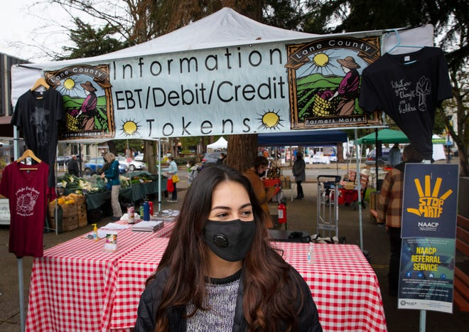 Winter Farmers Market manager Alexis Molinari oversees opening day in the Park Blocks of Eugene on Saturday.