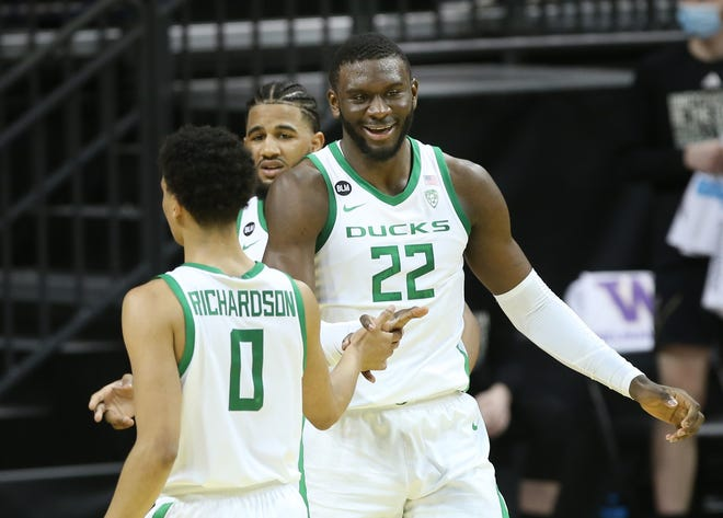 Oregon's Franck Kepnang, right, celebrates a play against Washington during the first half of their Pac12 game Saturday, Feb. 6, 2021.