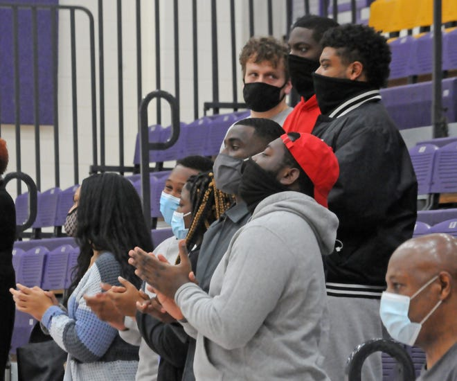"Kansas Wesleyan students applaud after the final closing hymn, ""We Shall Overcome,"" played by members of St. John's Missionary Baptist Church during the Black History Month celebration in Mabee Arena on Friday evening."