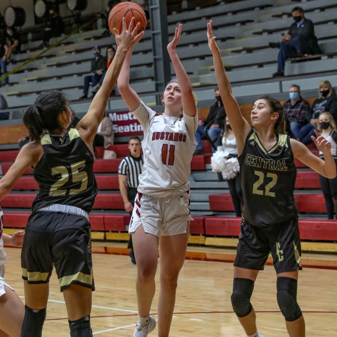 Andover Central's Madelyn Amekporfo (25) and Brittany Harshaw (22) contest a shot by Salina Central guard Landry Stewart (11) earlier this season.  The Jaguars and the Mustangs will meet for a third time Thursday in the Class 5A State Tournament at Emporia.