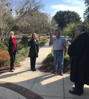 St. Johns County Soil and Water Conservation District members Mary Lawrence, Nicole Crosby and Chuck Owen take the oath of office.
