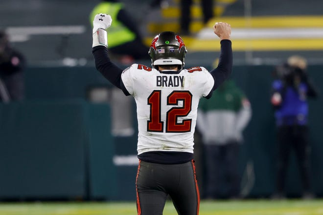 Tampa Bay Bucs quarterback Tom Brady reacts after winning the NFC championship against the Packers in Green Bay, Wis., last Sunday. If the Bucs win today Brady will be the second NFL quarterback to win a Super Bowl with two different teams.