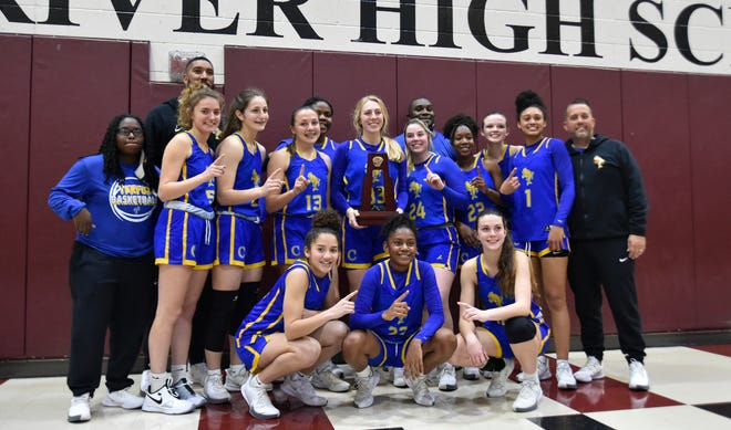 The Charlotte Tarpons departed the Pirates' gym with a district championship trophy after a 56-44 victory over Braden River in the Class 6A-District 11 final Friday night, Feb. 5  2021.