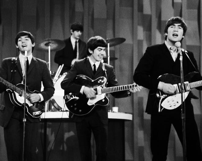 "In this Feb. 9, 1964 photo, The Beatles, from left, Paul McCartney, Ringo Starr on drums, George Harrison and John Lennon, perform for the CBS ""Ed Sullivan Show"" in New York, as they record a set that would later be shown on the Feb. 23 broadcast of the show. The Beatles made their first broadcast appearance on ""The Ed Sullivan Show,"" America's must-see weekly variety show, later in the day, officially kicking off Beatlemania."