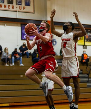 Dylan Singleton helped Lincoln defeat Lanphier 56-49 at Lober-Nika Gymnasium on Saturday. [JASON JOHNSON/SPECIAL TO THE STATE JOURNAL-REGISTER]