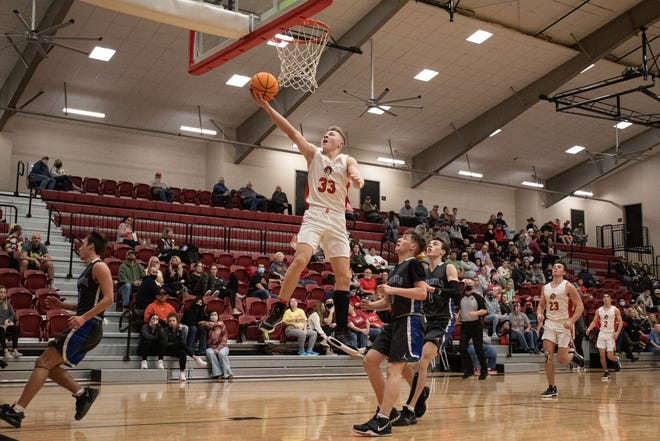 Dale's Dayton Forsythe (33) glides in for a basket against Newcastle Friday night.