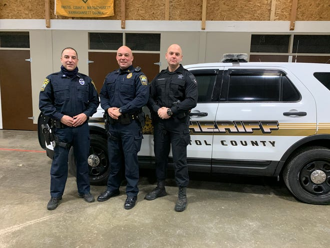 Group: From left, Fall River Police Officer Kevin Lopes, Sgt. Jeff Richard and Bristol County Sheriff's Office Officer Ryan Isherwood joined their four-legged partners in graduating from the firearms detection academy on Friday. Officer Isherwood also completed the explosives detection program.