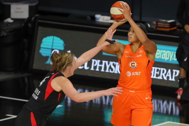 Connecticut Sun's Brionna Jones, right, shoots over Las Vegas Aces' Carolyn Swords during the first half of a WNBA basketball game Thursday, Aug. 20, 2020, in Bradenton, Fla.