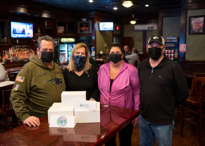 Dan Purcell, CEO of DC Holdings, Inc., Donna Bulger, director of Clear Path for Veterans New England, Jeanne Purcell, a Clear Path volunteer,  and Wayne Beauregard, Columbia Tavern owner are pictured at the tavern.