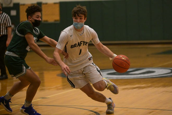 Callum Donagher goes to the rim for a layup during a February boys' basketball game vs. Bartlett.