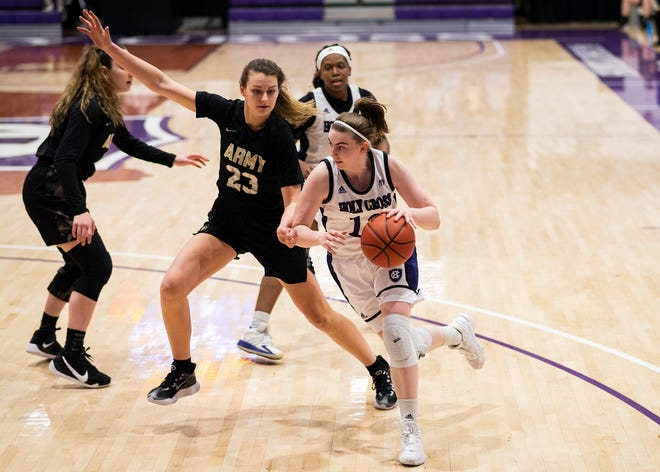 WORCESTER - Holy Cross's Bronagh Power-Cassidy drives for the hoop during the game against Army on Saturday, February 6, 2021.