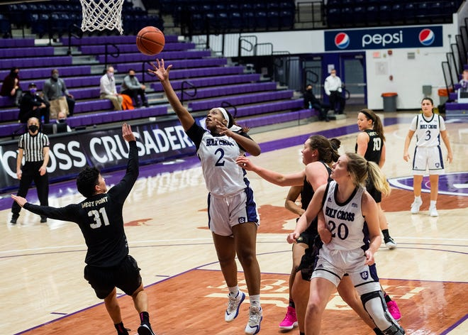 Oluchi Ezemma releases a shot in the lane Saturday against Army.