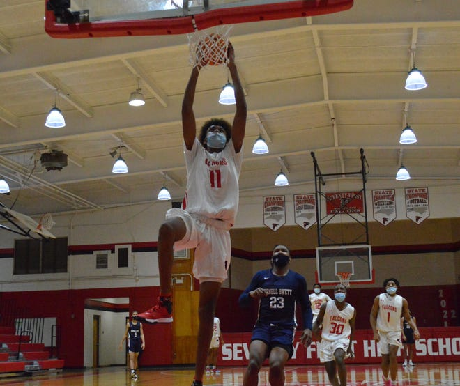 A 6-foot-8 sophomore at Seventy-First, James Scott had a pair of dunks in the Falcons' 79-46 win against Purnell Swett on Friday.