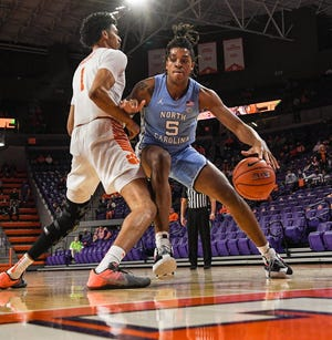North Carolina's Armando Bacot, right, takes a bump and tries to put a move on Clemson's Jonathan Baehre on Tuesday night at Littlejohn Coliseum.