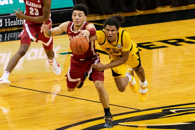Missouri's Dru Smith, right, and Alabama's Jahvon Quinerly, left, battle for a loose ball during a game Saturday at Mizzou Arena. Missouri won 68-65.