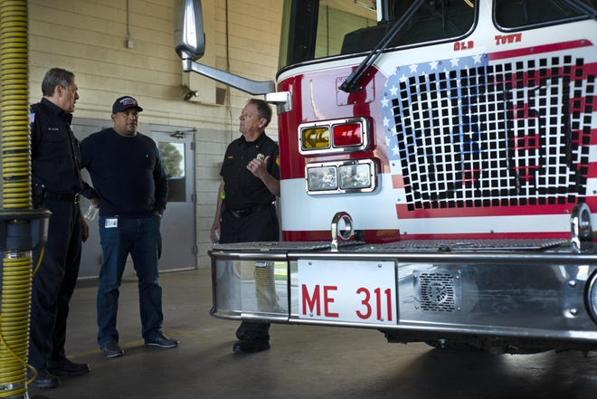 Victorville Fire Department personnel converse in Station 311 in May 2019.