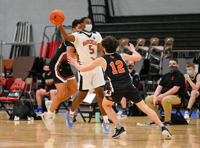 Tyrone Countrymon of Marblehead passes the ball during a game versus Beverly at Marblehead High School on Friday, Feb. 5.