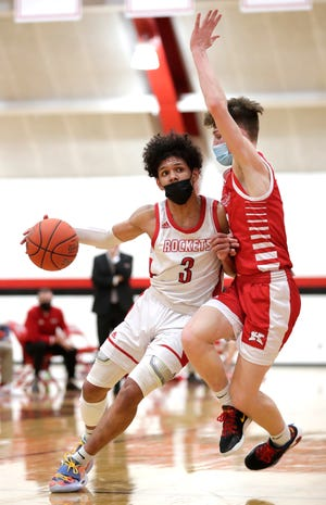 Neenah's Chevalier Emery Jr. (3) drives to the basket against Kimberly's Jackson Paveletzke (13) during their boys basketball game Feb. 5 in Neenah.