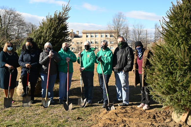 From left: Superintendent Sancha K. Gray, Board President Sheila Etienne, Board Vice President and AP Toy Drive Trustee Barbara Lesinski, AP Toy Drive Founder and Board Member Connie Breech, AP Toy Drive Trustees Micky Carter, Beth Foderaro and Jason Dermer, and MJ Schmidt of Madison Marquette participate in the ceremonial tree planting.
