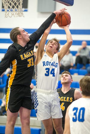 Colonel Crawford's Chase Walker is called for a foul on Wynford's Jaron Filliater.