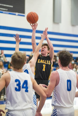 Colonel Crawford's Mason Studer shoots a mid-range jumper over Wynford's James Schiefer.