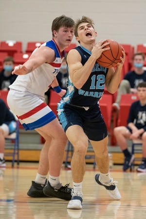 Adena's Preston Sykes goes in for a shot against Zane Trace in a game earlier this season, The Warriors earned a No. 4 seed on Sunday in the Division III Southeast District tournament draw.