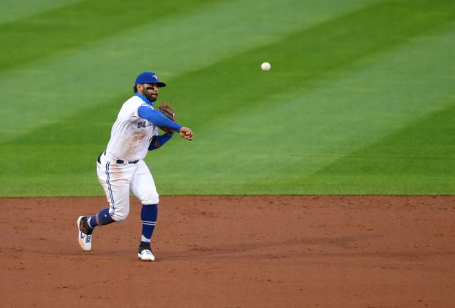 Blue Jays second baseman Jonathan Villar (30) throws to first base against the New York Yankees at Sahlen Field in Buffalo. Mandatory Credit: Timothy T. Ludwig-USA TODAY Sports