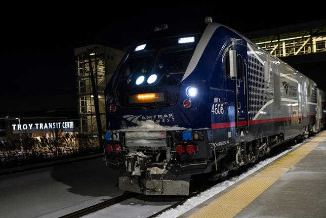 An Amtrak train approaches the Troy Transit Center in Michigan on Feb. 5. Amtrak mandated masks for all passengers and employees last spring.