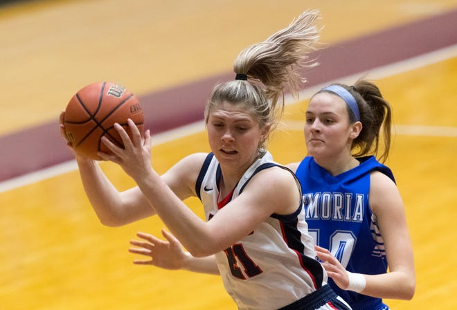 Heritage Hills' Rebekah Gordon (21) pulls down a rebound as the Memorial Lady Tigers play the Heritage Hills Lady Patriots  during the 2021 Girls Basketball 3A Sectional semifinals at Mt. Vernon High School in Mt. Vernon, Ind., Friday evening, Feb. 5, 2021.
