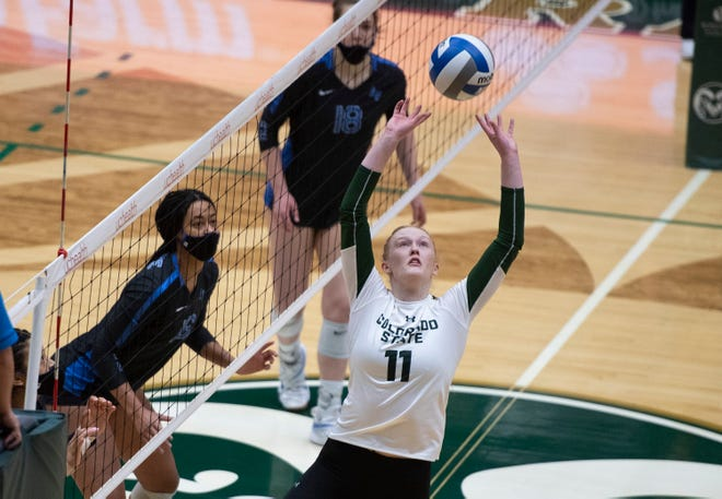 Colorado State Rams setter Ciera Zimmerman (11) sets the ball in the first set of the match at Moby Arena at Colorado State University in Fort Collins, Colo. on Friday, Feb. 5, 2021.