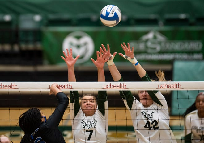 CSU middle blockers Sasha Colombo (7) and Karina Leber (42) block the ball in the 2nd set of CSU's win over Air Force on Friday night. The Rams were swept by Air Force on Saturday night in game two of the series.